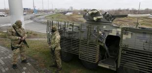 Бронемашини й озброєні патрулі Нацгвардії в Києві