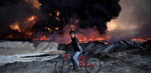Претенденты на фото года по версии The Guardian: Трамп, беженцы и битва за Мосул
