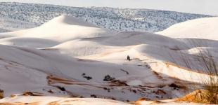 Теплая зима в Европе стала причиной снега в пустыне Сахара
