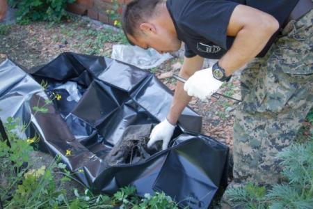 Вещи погибших в Иловайском котле бойцов нашли на свалке возле Днепра